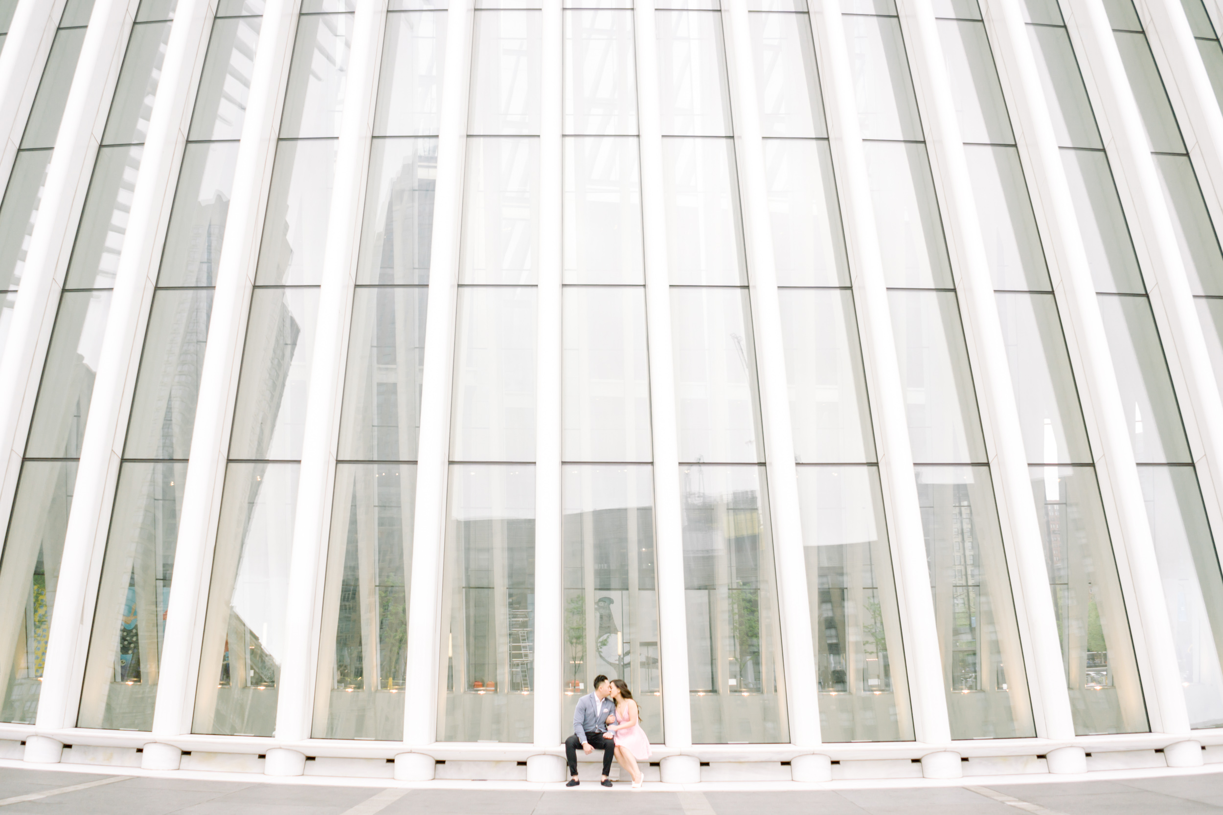 A couple at the World Trade Center, New York City for their engagement photos